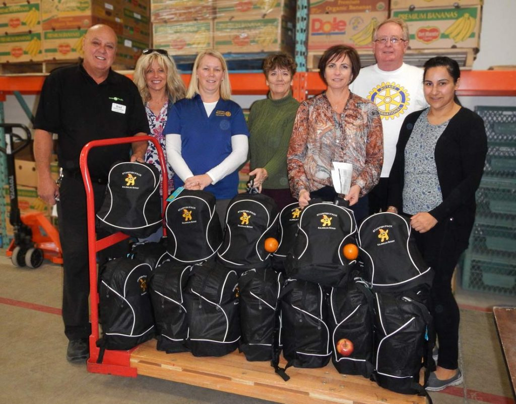 Kalamalka Rotary members with Save On Foods Assistant Manager Brad Boivin